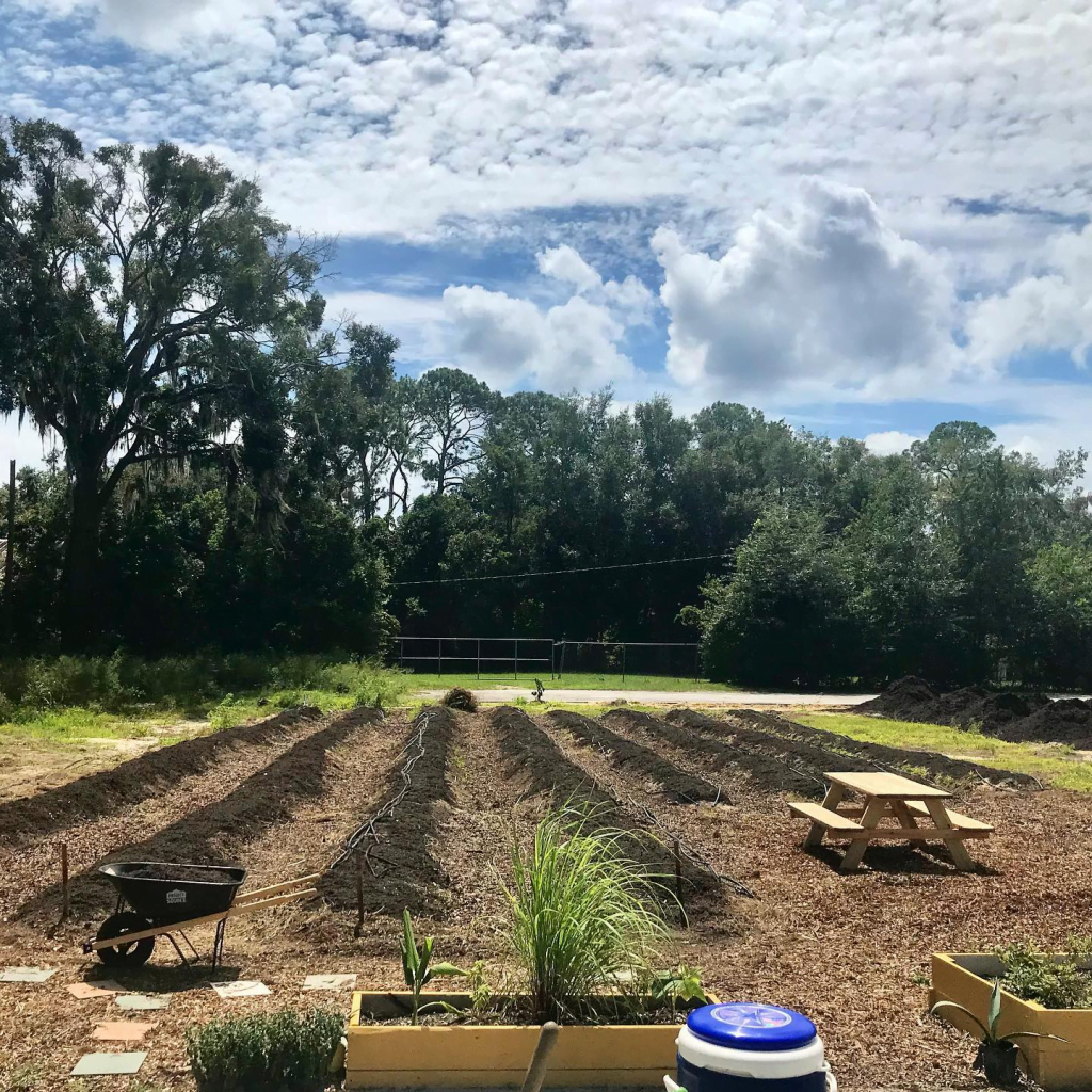 The Gainesville Giving Garden space with rows of soil ready for planting